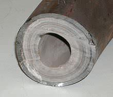 Limescale in a pipe reduces the flow of water.