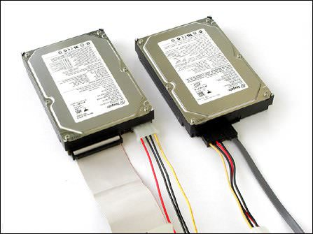 SATA (right) and IDE (left) hard drives. SATA has data cable on right and power cable on left. IDE data cable is ribbon-like (on the left)