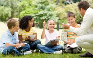 Students doing schoolwork outside