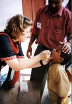A child being vaccinated against polio.