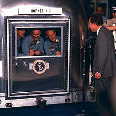 Apollo11 crew in quarantine. L to R  Neil A. Armstrong; Michael Collins; Edwin E. Aldrin Jr. and President Nixon welcoming the crew