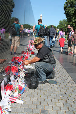 Friends and family of Vietnam war veterans honoring lost loved ones in Washington DC
