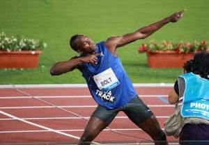 "Bolt striking his signature ""To Di World"" pose"