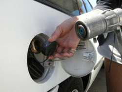Closeup of an LPG nozzle using which LPG is being pumped into a car