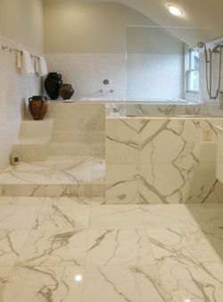 Calcutta Marble tiles in a bathroom. Notice how no two tiles have the same design