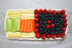 Fruit and veggie platter with cheddar cheese sticks,celeries, carrots; strawberries and blueberries