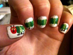 Nail art inspired by the children's book The Very Hungry Caterpillar.