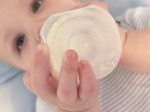 Infant drinking from a bottle