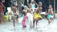 Happy kids dancing in the rain