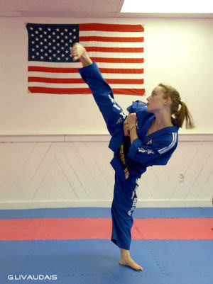 A girl practicing a Taekwondo kick