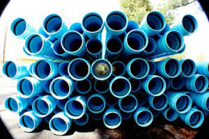 Stacked blue PVC pipes