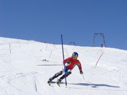 Skiing:man leaning forward, facing ahead