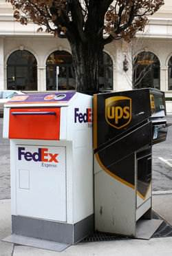 FedEx and UPS shipping dropoff boxes.