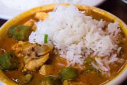 Gumbo with chicken and okra topped with rice