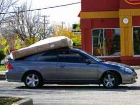 Honda Civic Coupe, also serves as a luggage rack