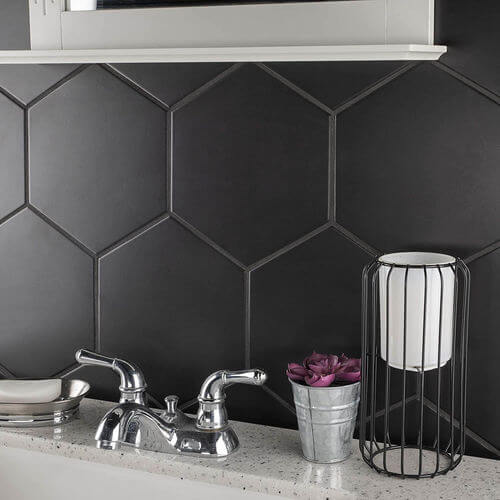 See SomerTile's textured black hexagonal porcelain wall and floor tiles.