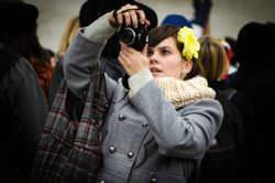 A photographer shooting with a Nikon D5100