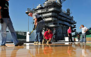 Putting Hardwood on steel for a basketball court aboard the aircraft carrier USS Carl Vinson.