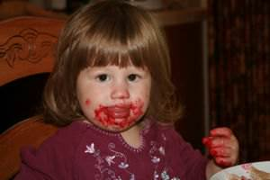 A kid eating some home made jam