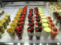 Gelato cups with various toppings in Italy.