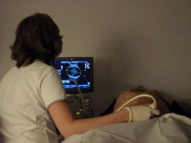 Ultrasonography being performed to check the fetal movement