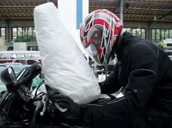 An Airbag on a motorcycle. Airbags are deployed as a result of rapid negative acceleration in a vehicle.
