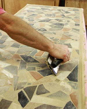Applying grout with a grout float.
