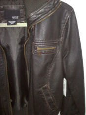 A brown faux leather jacket.