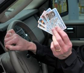 A driver displays Passport Card at the border