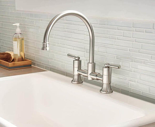 See Delta's Westchester Bridge Two Handled Faucet, Stainless.