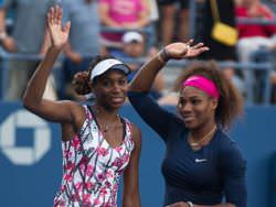 Venus (L) and Serena (R) Williams at the US Open 2012