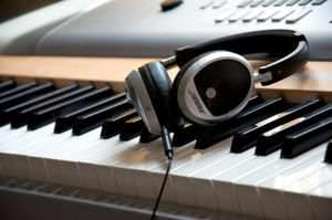 Bose on ear headphones on a Yamaha DGX 620 digital piano