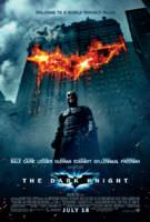 Movie poster for Batman:The Dark Knight. Batman is in the foreground with a burning building in the background. The fire in the building looks like a bat.
