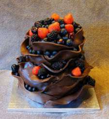 A chocolate cake topped with berries