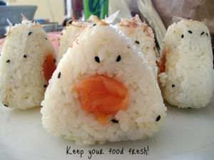 Smoked Salmon Onigiri-White Rice balls filled with fresh smoked salmon covered in fish flakes and roasted sesame seeds