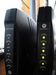 Modems by Comcast(L) and Motorola(R)
