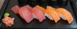 Nigirizushi is usually served in pairs. Shown above is a plate of tuna and salmon nigiri