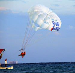 Parasailing (with a parachute, and grounded to the boat)