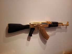 A golden AK47 seen at Parlor Gallery in Asbury Park.