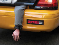 An ad for the TV series The Sopranos, which is about the mafia. The ad is in the form of what looks like a human arm dangling out of a taxi's trunk.