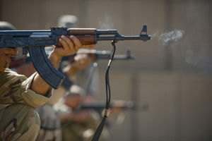 Iraqi airmen fire AK-47s during a firing drill.