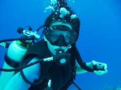 A SCUBA diver with underwater breathing equipment