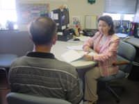 A Probation Officer with the Missouri Department of Corrections interviewing a drug-related offense probationer