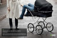 An ad with an adult's long legs dangling out of a baby's stroller. The ad urges people to spend time with their kids while they are still kids.