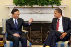 President Obama and Chinese Foreign Minister Yang Jiechi wearing suits.
