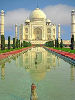 The Taj Mahal is a white marble mausoleum in India.