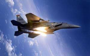 An F-15E Strike Eagle pops flares during an aerial training dog fight