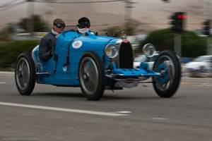 An old Bugatti participating in The 2010 International Bugatti Rally passes through Morro Bay, CA