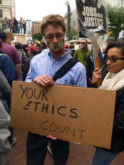 A protestant with a message on Ethics during Occupy Portland protest