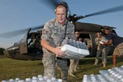 A National Guard soldier delivering bottled water in Virginia